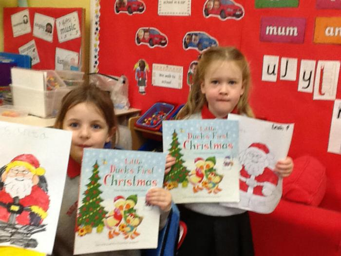 Sparkles brings a present to  Isla and Leah for building Santa's name and super colouring!