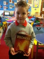 Alfie tell us all about volcanos after 'silent' reading' time.