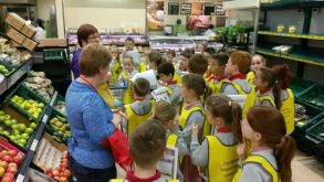 tesco p3 p4 P1 and p2 pupils recently went on a 'farm to fork' visit to tesco newry this was  a very exciting day out, during which the children learned lots about where.